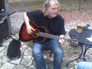 Ray Wylie Hubbard and bored dog