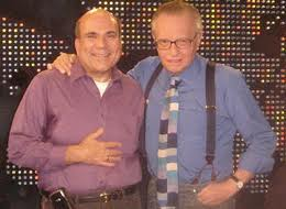 Oops. No beads on Larry King.