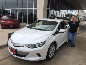 """Nerissa by her 2017 Chevy Volt and wearing an """"It's All Good"""" T-shirt"""