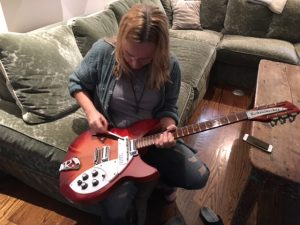 "Melissa showing me her rare Rickenbaker ""Cadillac"", an electric 12-string that can be turned into a 6-string with an awkward device"