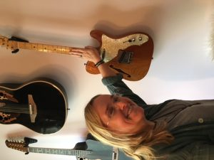 "Melissa showing me her all-time favorite guitar, a Fender Strat. ""If there's a fire and I can only grab one guitar, it's this one."""