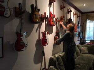 Melissa Etheridge showing me some of her guitars in her home